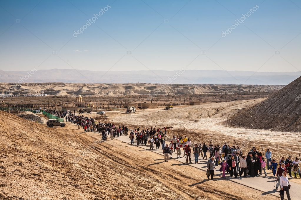 Pilgrims and tourists walking through desert