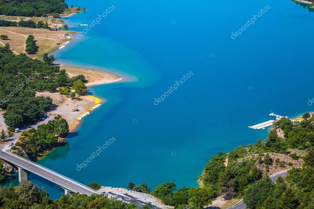 Bridge on lake with turquoise water