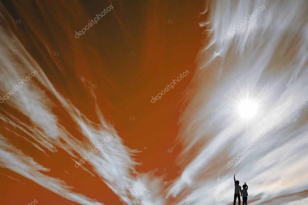 Two boys look at clouds