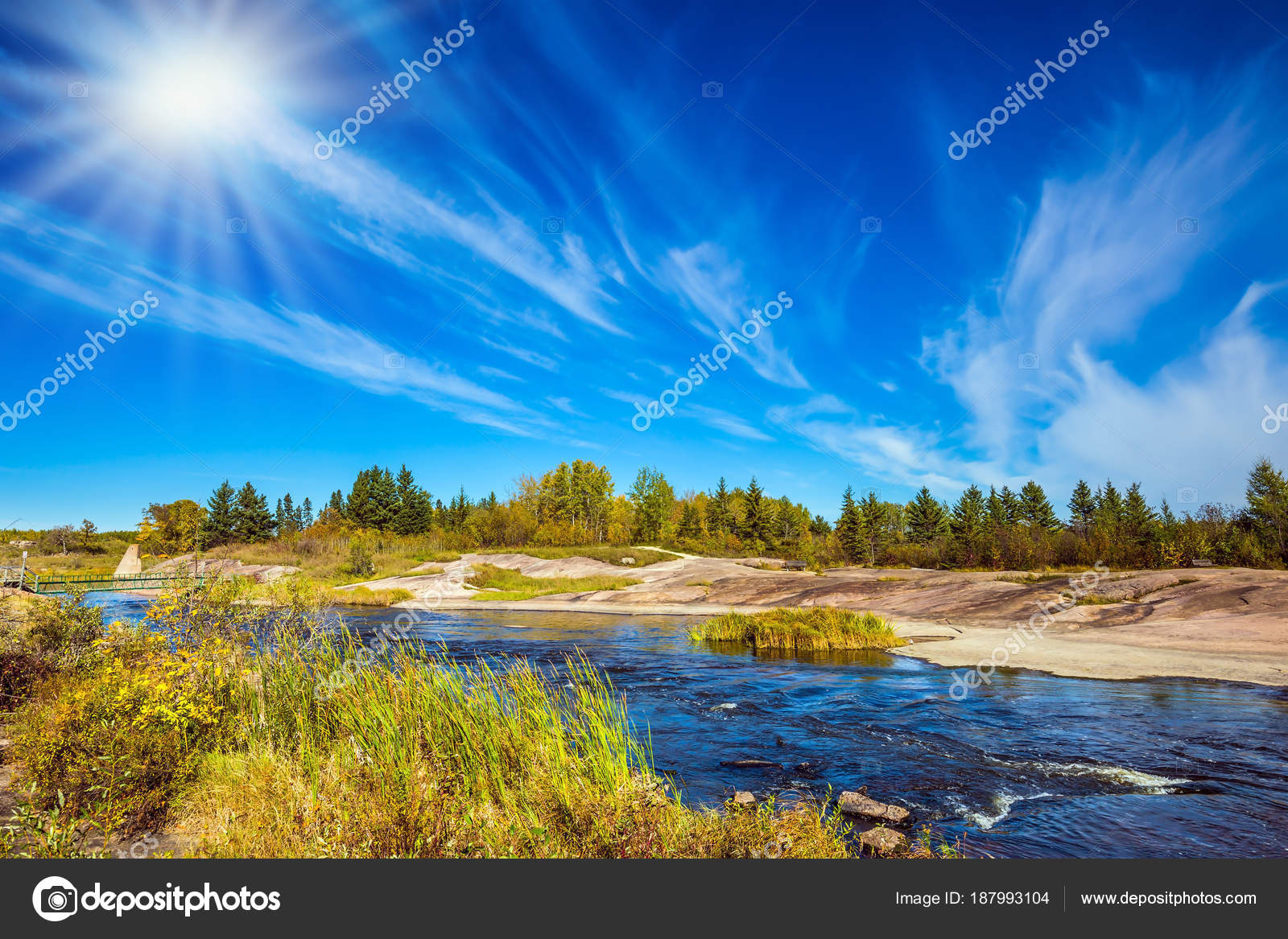 indian summer manitoba canada improbable clouds autumn sun river