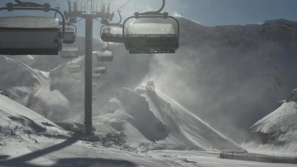 Strong wind storm chair lifts do not work on top of ski resort Gorky Gorod 2200 meters above sea level stock footage video