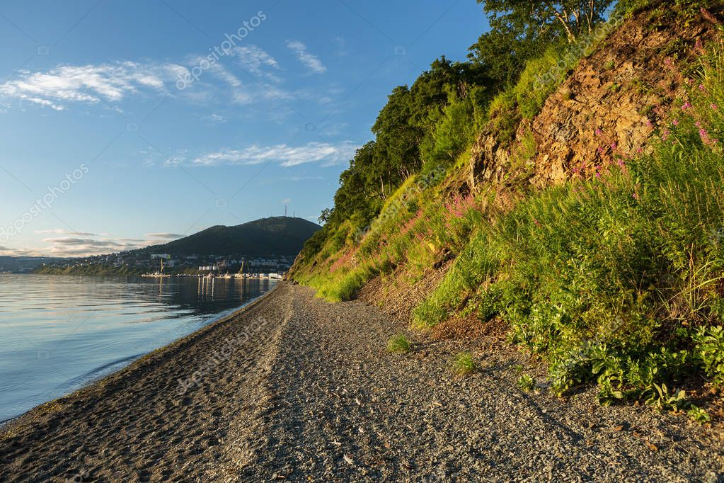 City beach on Ozernovskaya spit, shore of Avacha Bay in Petropavlovsk-Kamchatsky.