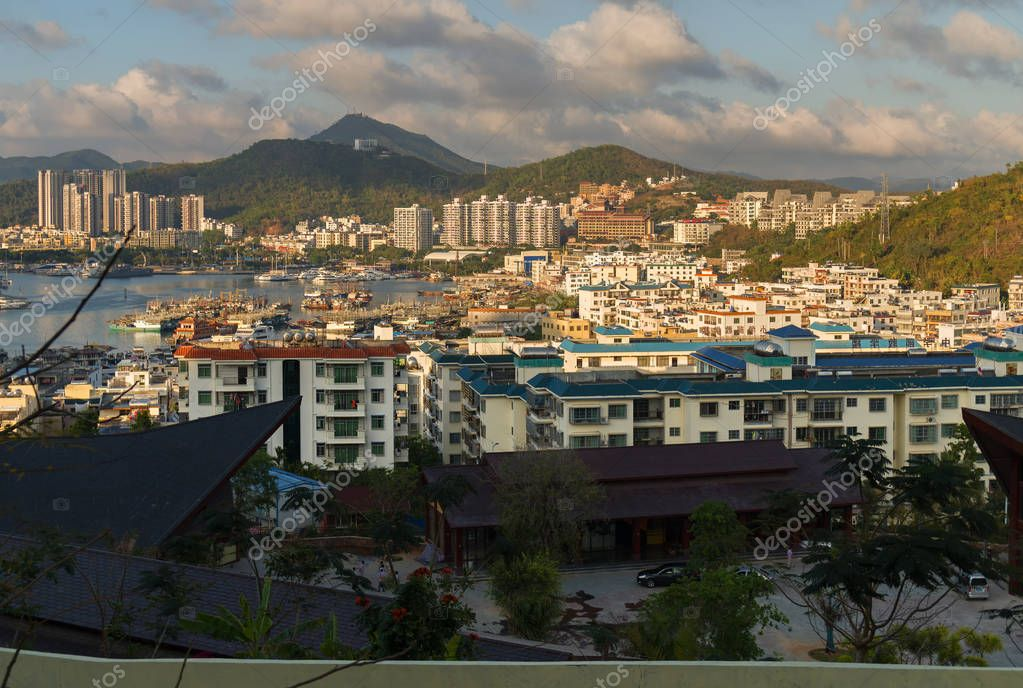 Evening view of Sanya from the top of a hill in a Luhuitou Park