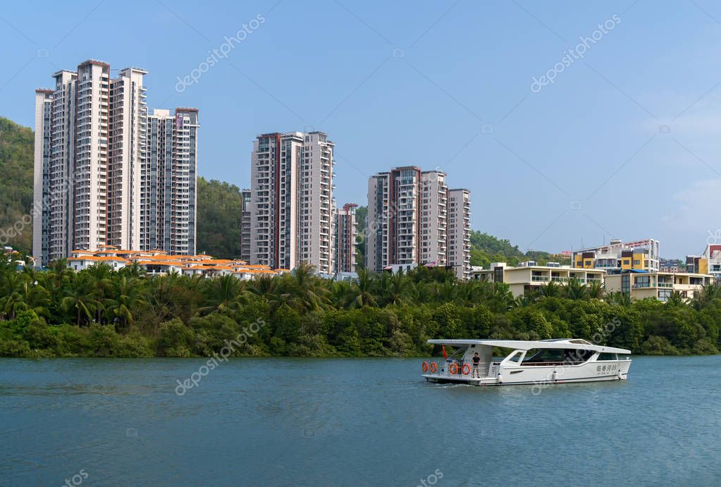 Residential houses on the Linchun River bank in the city of Sanya