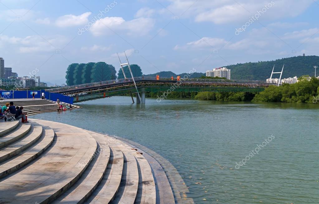 New pedestrian bridge is built across the Linchun River bank in the city of Sanya