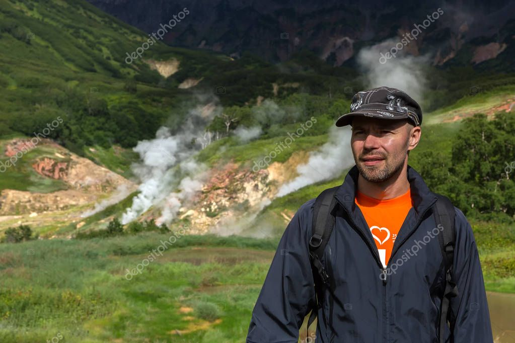 Tourist in the background of famous Valley of Geysers.