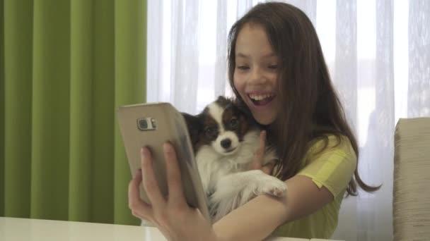 Happy teenage girl doing selfie with her dog stock footage video
