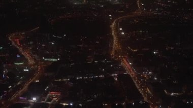 Night Dubai view from the window of flying plane.