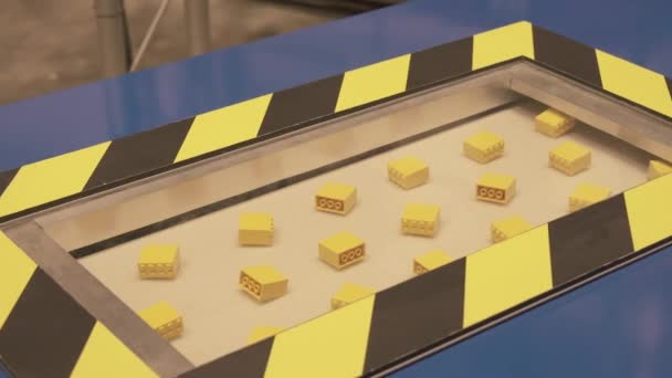 Demonstration of the technological process of manufacturing the details of the designer in the Lego factory in Dubai Legoland at Dubai Parks and Resorts stock footage video