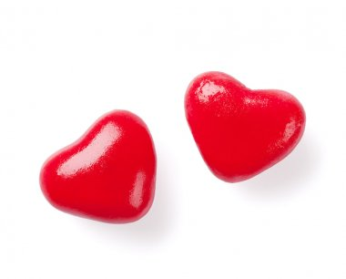 Two red candy hearts