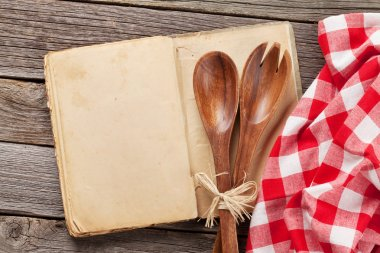 Blank vintage cooking book and utensils