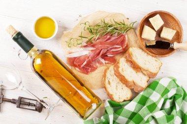 Wine, prosciutto, parmesan and olive oil
