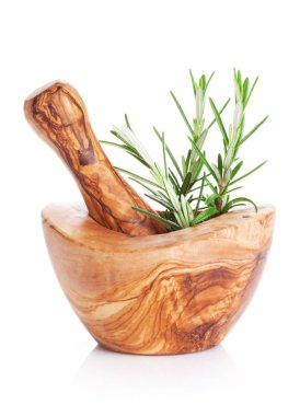 Garden rosemary herb in mortar