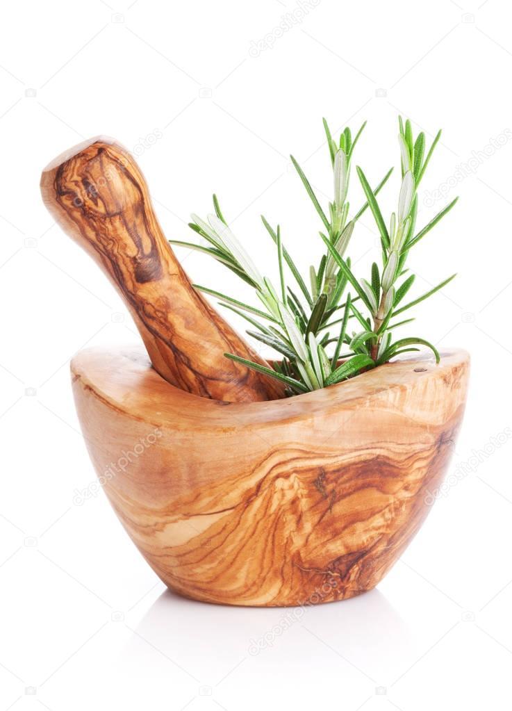 Garden rosemary herb in mortar