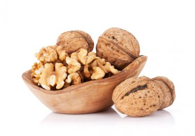 Walnut nuts in wooden bowl