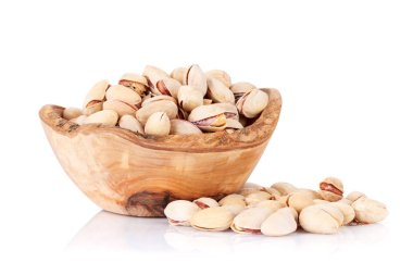 Pistachios nuts in wooden bowl
