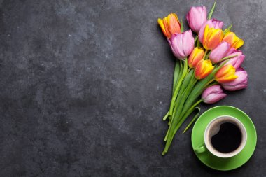Fresh colorful tulip flowers and coffee