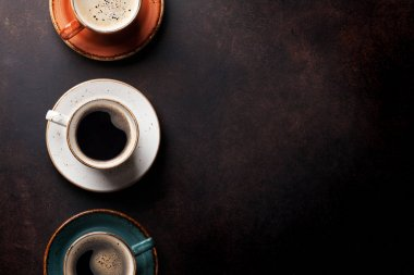 Coffee cups on old table
