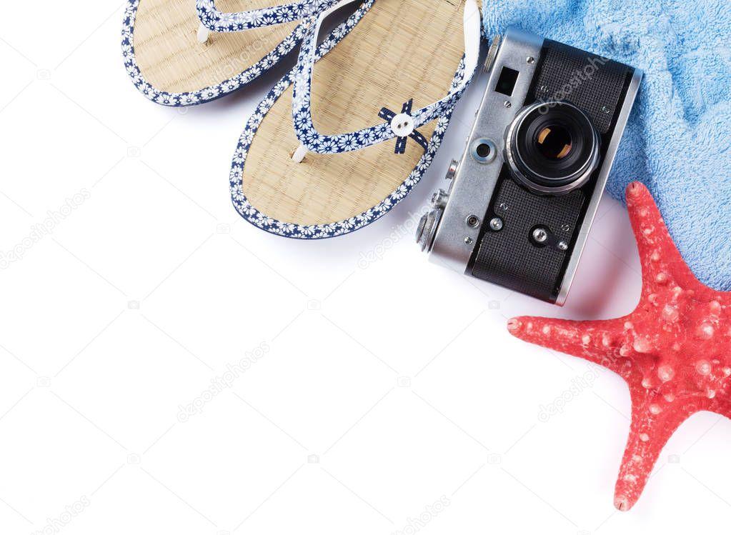 Flip flops, camera and towel