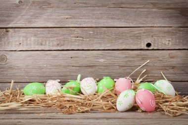 Easter eggs in front of wooden wall