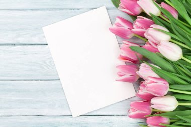 Easter greeting card with pink tulips