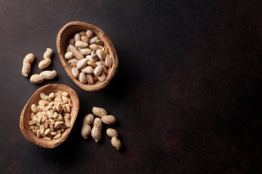 peanuts and pistachios in bowls