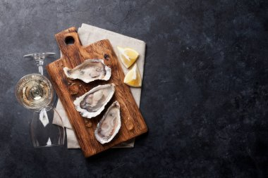 oysters, lemon and white wine