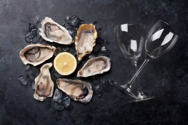 oysters, lemon and wine glasse