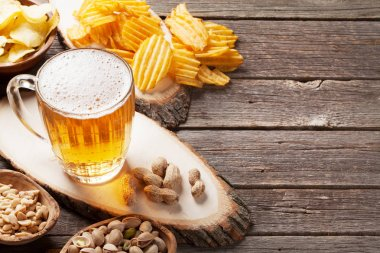 beer and snacks on table