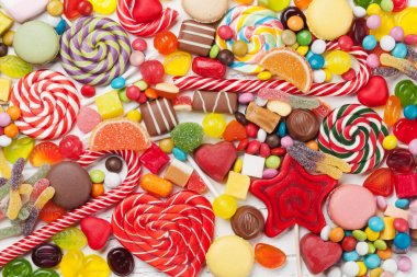 Colorful sweets. Lollipops and candies. Top view close up