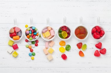 Colorful sweets. Lollipops, marmalade and candies. Top view