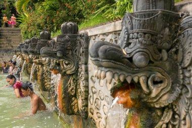 People take a bath in thermal Banjar Tega