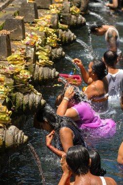 Balinese Hindu families   Tirta Empul