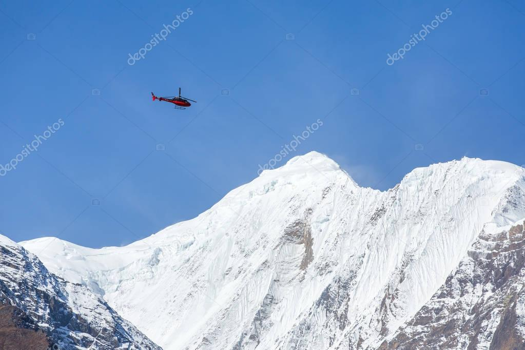 Rescue helicopter in high Himalayan mountains