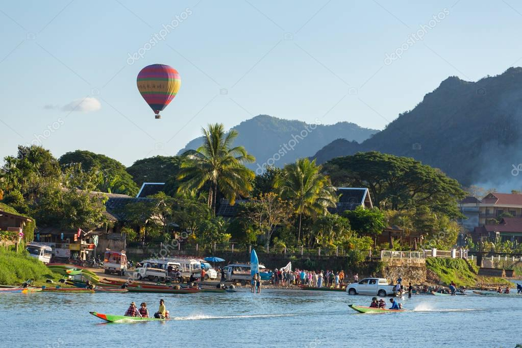 tourists riding speedboats