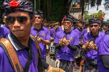 Balinese people participating in cremation ceremony