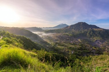 Sunrise over caldera of Batur volcano