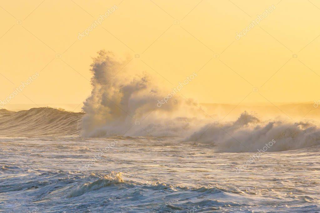 Big stormy waves crashing over Portuguese coast during sunset