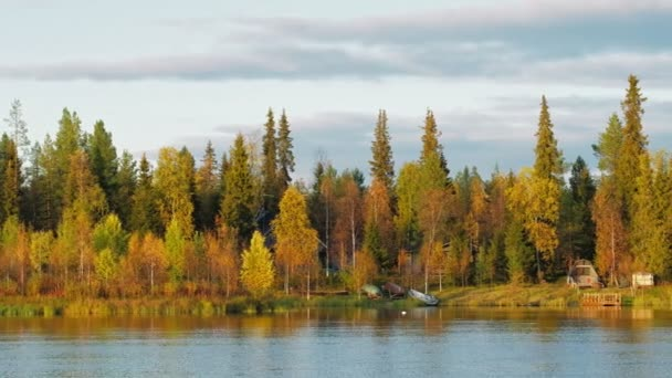 Finnish ruska autumn landscape with lake country house in Finland.