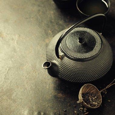 Teapot on vintage background