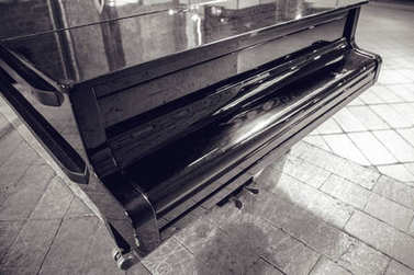 Old piano close-up. Black-white photo.
