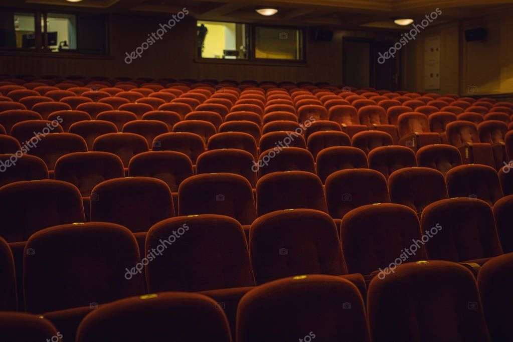Red armchairs of old theater as conceptual background. stock vector