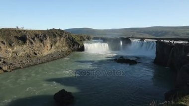 Picturesque landscape of a mountain waterfall and traditional nature of Iceland. HD Footage.