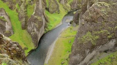 Picturesque landscape of a mountain river with traditional nature of Iceland. Slow Motion Footage.
