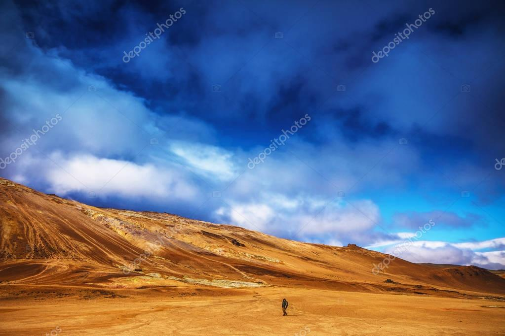 Traveler against  picturesque Icelandic landscape.