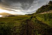 Beautiful scenic landscape of amazing Scotland nature and mountain trail road.