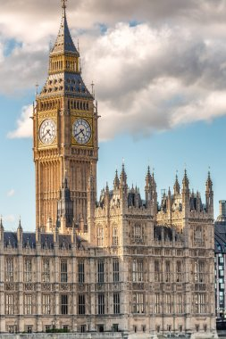 The Big Ben and Houses of Parliament against blue sky - London,