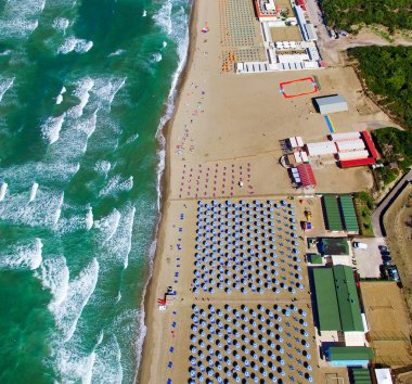 Overhead aerial view of Bathhouse, vegetation and sea waves