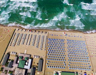 Overhead view of Beach Umbrellas on a beautiful Sandy Beach
