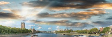 London skyline at sunset along river Thames
